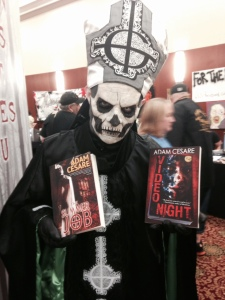 An insanely good Papa Emeritus cosplayer blesses my books. For Satan.